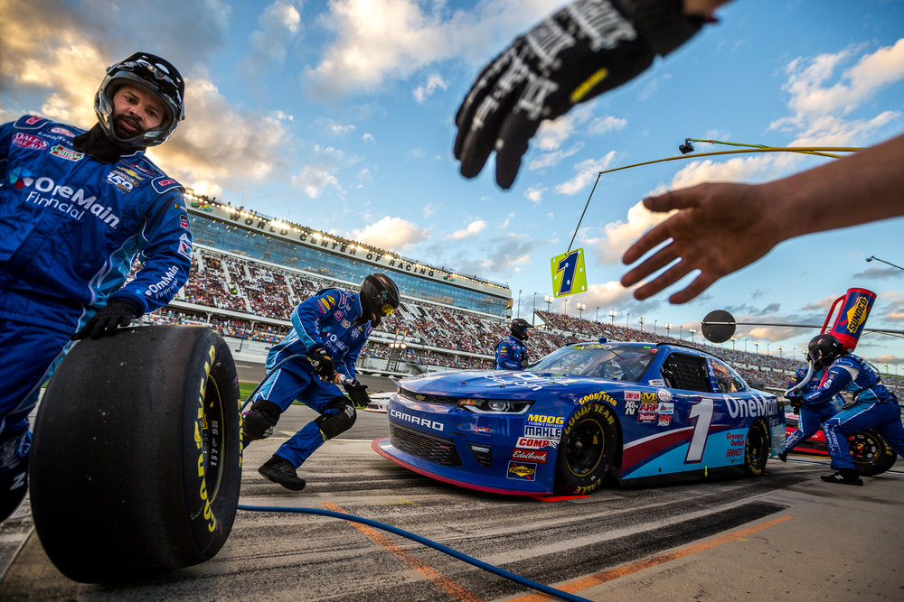 Elliott Sadler's OneMain Financial Chevrolet crew gets to work during a pitstop at the NASCAR XFINITY series PowerShares QQQ 300 race at Daytona International Speedway in Daytona Beach, Fla., on Saturday, Feb. 25, 2017.
