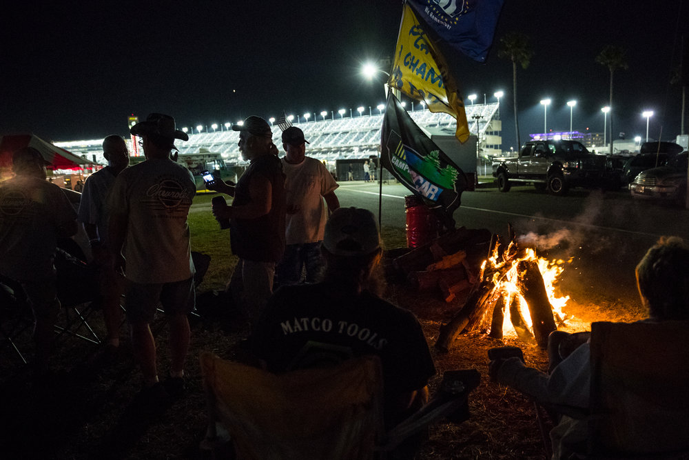 Fans camp out and tailgate on the infield at Daytona International Speedway, between the NASCAR XFINITY series PowerShares QQQ 300 race and the Daytona 500 race, in Daytona Beach, Fla., on Saturday, Feb. 25, 2017.