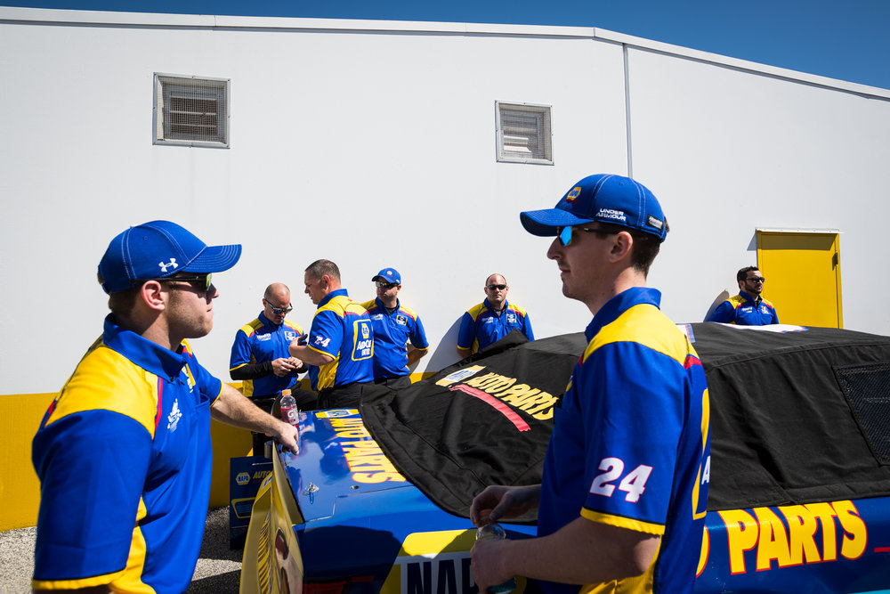 Chase Elliott's NAPA Chevrolet crew waits for a pre-race technical inspection before the Daytona 500 NASCAR race at Daytona International Speedway in Daytona Beach, Fla., on Sunday, Feb. 26, 2017.