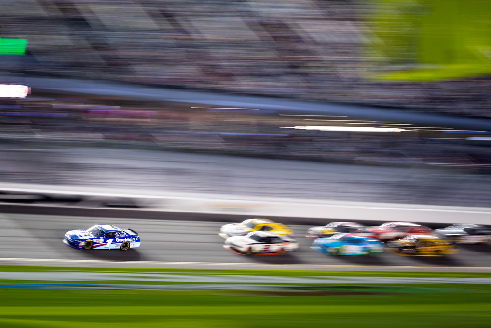 Drivers compete for position during the NASCAR XFINITY series PowerShares QQQ 300 race at Daytona International Speedway in Daytona Beach, Fla., on Saturday, Feb. 25, 2017.
