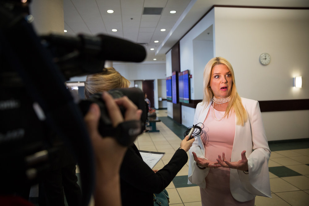 "Florida Attorney General Pam Bondi addresses the media following an injunction hearing regarding her alleged stalker, William Norman Wilkes, at the Hillsborough County Courthouse in downtown Tampa on Wednesday, May 17, 2017. He has peeked through the windows of her Tampa home and sent unsolicited text messages expressing his appreciation for her ""physical attributes,"" according to Bondi."
