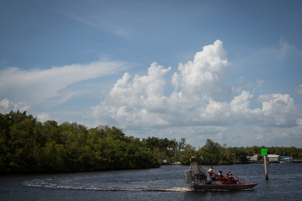 An airboat charter cruises past downtown Everglades City, Fla., on Wednesday, May 31, 2017.