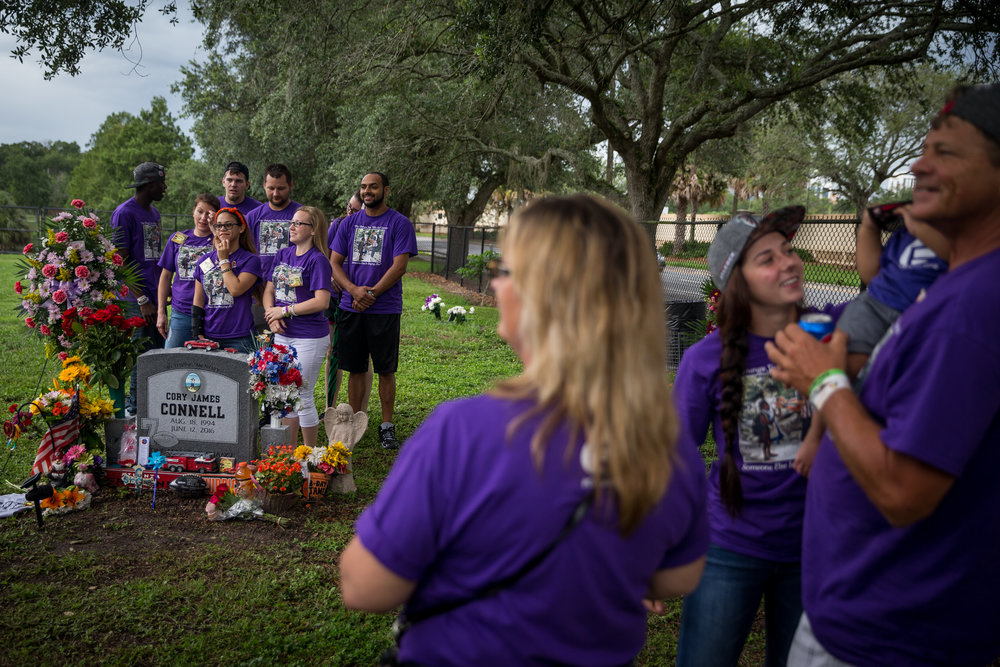Friends and family of Cory James Connell celebrate his life at his grave on the one-year anniversary of the shooting at Pulse nightclub, at Greenwood Cemetery in Orlando, Fla., on Monday, June 12, 2017. Cory James Connell was one of the 49 killed at Pulse, a gay nightclub, one year earlier.