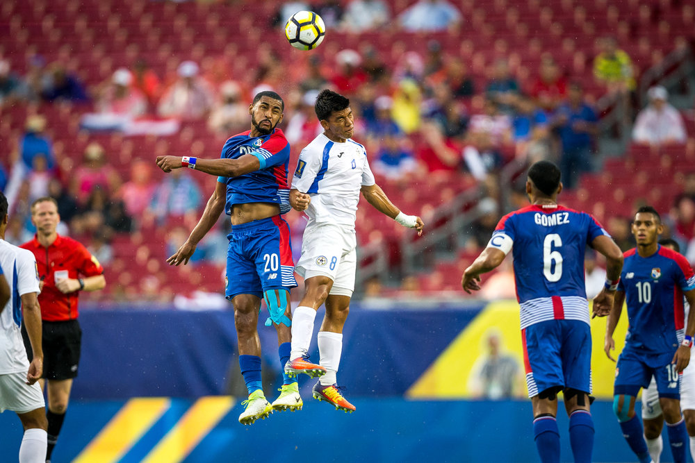 Panama's Anibal Godoy and Nicaragua's Marlon Lopez compete for the ball in the first half of a CONCACAF Gold Cup soccer match.