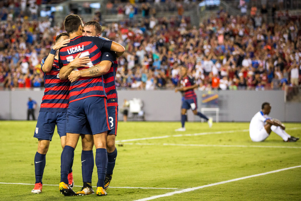 United States' Jordan Morris celebrates with teammates after scoring one of his two goals for the night during the second half of a CONCACAF Gold Cup soccer match.