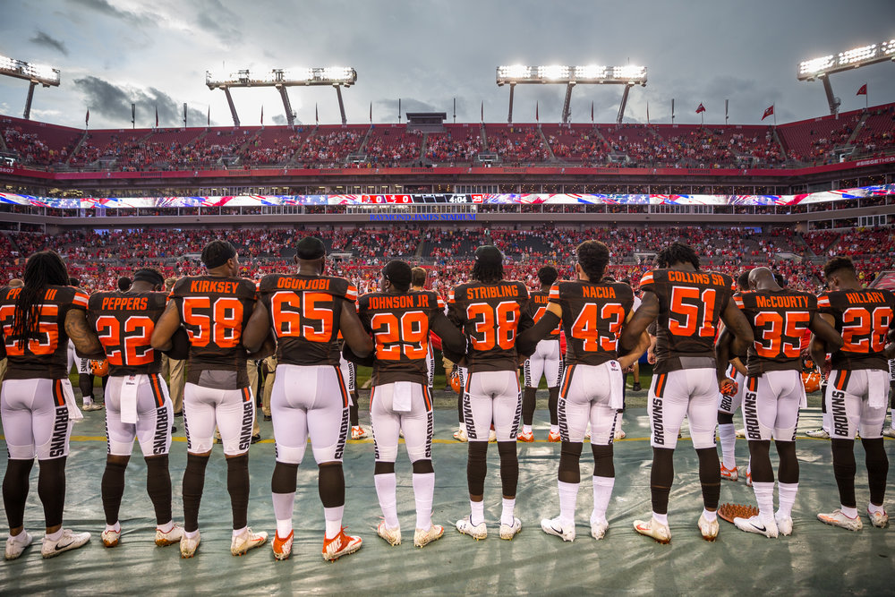 Cleveland Browns players lock arms during the national anthem