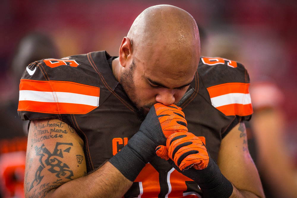 Cleveland Browns defensive end Xavier Cooper (96) prays before the game.