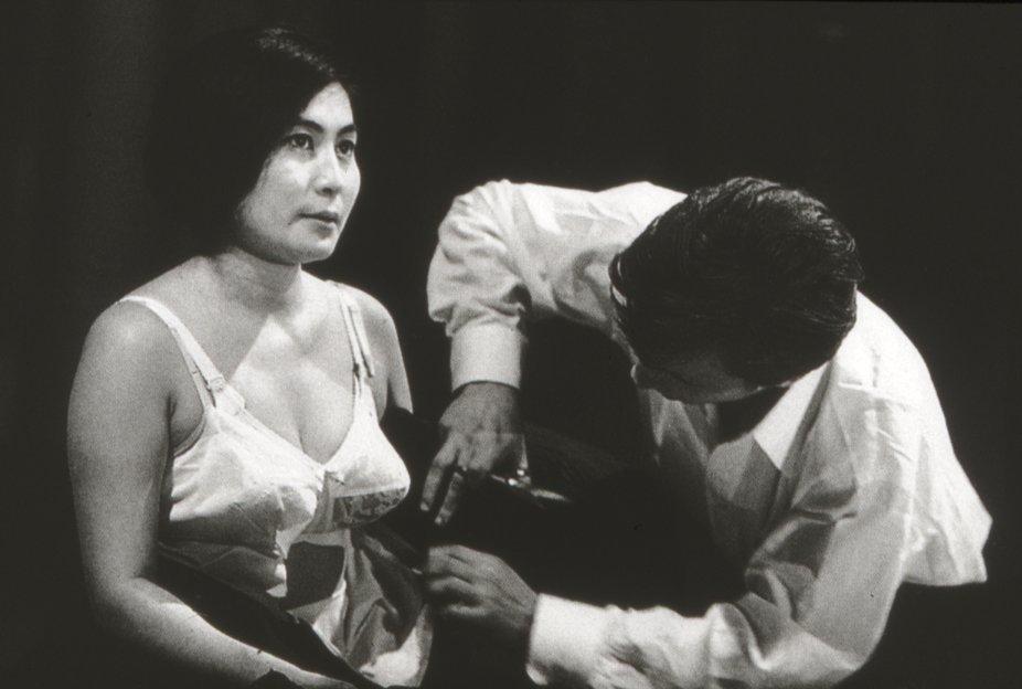 (Yoko Ono performing her art piece Cut Piece)