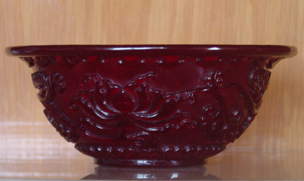 carved transparent ruby-red glass bowl.jpg
