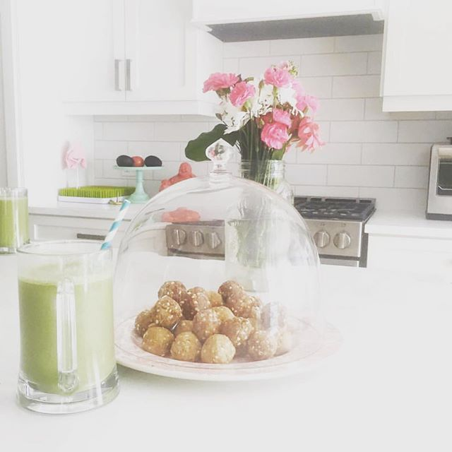 """On way home from Boston and soooooo going straight back out for a fresh bouquet, plan tomorrow's GreenBelly's, and make three batches of these nut butter balls!! #recipeinstories 💐🌱 WARNING: I am in the first hour of a 10 hour drive and just had a thought 👇🏻... so feel free to continue scrolling if you don't want to hear my thoughts ;))) 🤓 There does come a time you crave greens, homemade, healthy, and food prep. 🌱💐 As a recovering binge dieter and fad eater - I promise that until it became a one day at a time routine, I would fail by 9pm on day 1 eeeeevery time. 💐🌱 Now it's not an obsession. It's a lifestyle. I enjoy my time away, enjoy @californiapizzakitchen and don't think once about my jeans not fitting or belly bloat. 🌱🍕 On the 10 hour drive home food is packed, water is a plenty, and I don't consider the drive home an excuse to binge on fast food. 🍟🌱 Then once home, I crave a lifestyle of prep and health elevating habits. 🌱✨ I used to wonder how people honestly """"have that body"""" and still go out for dinner. Or wonder """"what does it feel like to not want to binge"""" once my diet already is off schedule. ✨🌱 Now, it's my daily routine that changed years of excuses and bingeing and missing out and self-sabotage and body shaming. It's creating consistency within your reality. It's health focus amongst the daily chaos. It's letting go of the bikini body obsession that GETS you the bikini body you once obsessed about! Make it healthy. Make it daily. Make it your lifestyle. And it WILL happen. 🌱✨ Aaaaaaand THAT is where my head is at on our first hour of our road trip home :))))) ✨🏡 #roadtrip #healthyfood #bikinibody #homemade #lifestyle #makelovetoyourlife"""