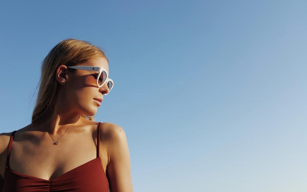 dress Zara overalls Zara knitwear H&M swimsuit H&M ring Cartier sunglasses Emmanuelle Khanh