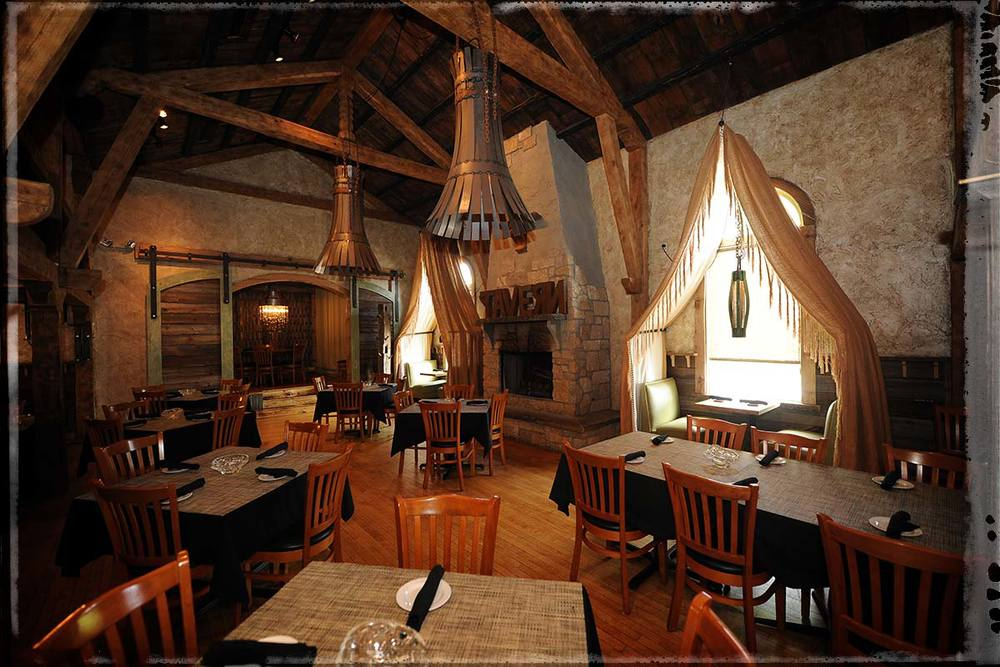 Enjoy a rustic dining experience set amidst reclaimed natural surfaces.