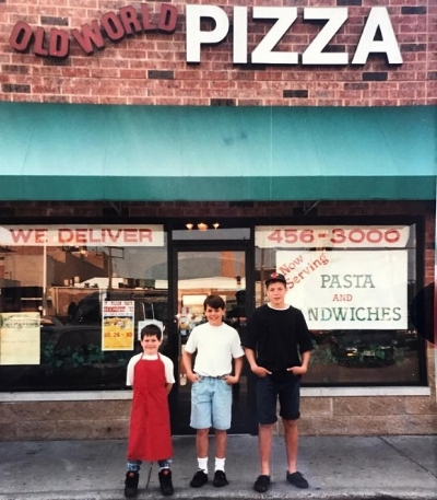 from left, James, Brian, and Mike. Pictured in front of Old World Pizza, their dad's first pizza place.