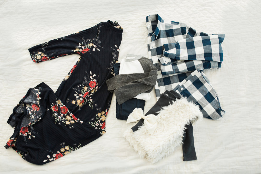 Floral dress for mom. Navy and white gingham for dad, paired with denim pants. Boy in grey baseball tee. Girl in grey thermal and fur vest, would look amazing with red/maroon leggings or jeans.
