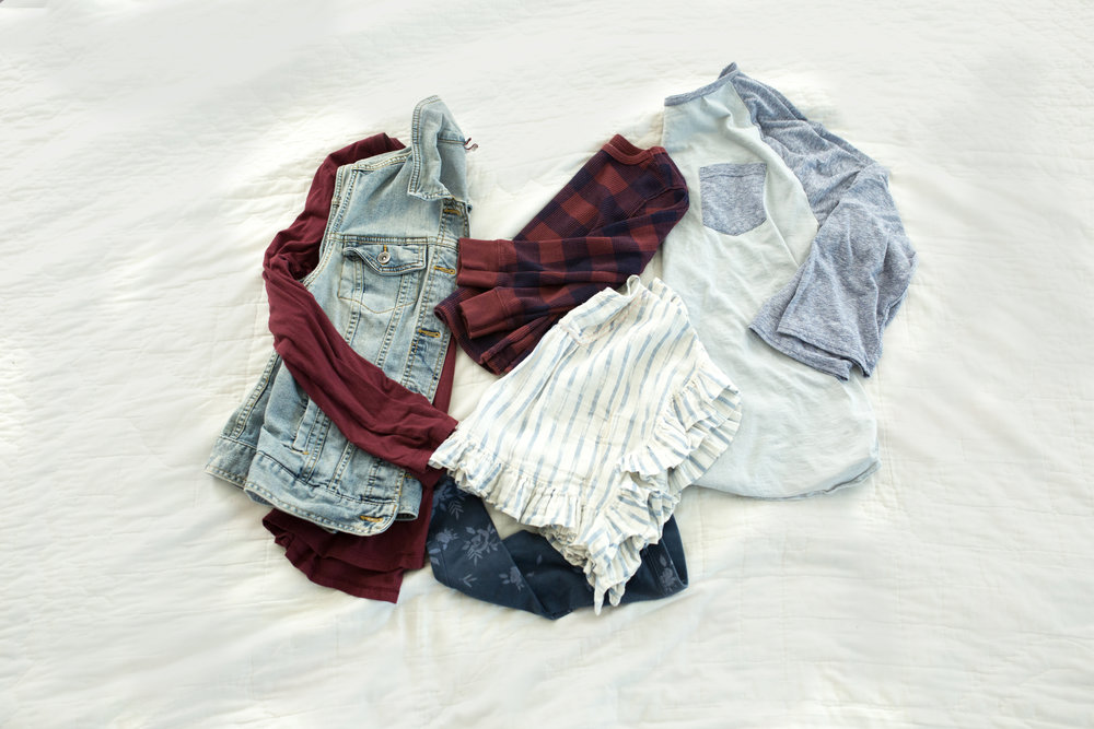 Girl in fun striped flowy top and floral leggings. Boy in navy and maroon gingham print thermal with jeans. Dad in baseball tee with jeans. Mom in maroon top and denim vest. Pair with a skirt or skinny dark jeans with ankle boots.