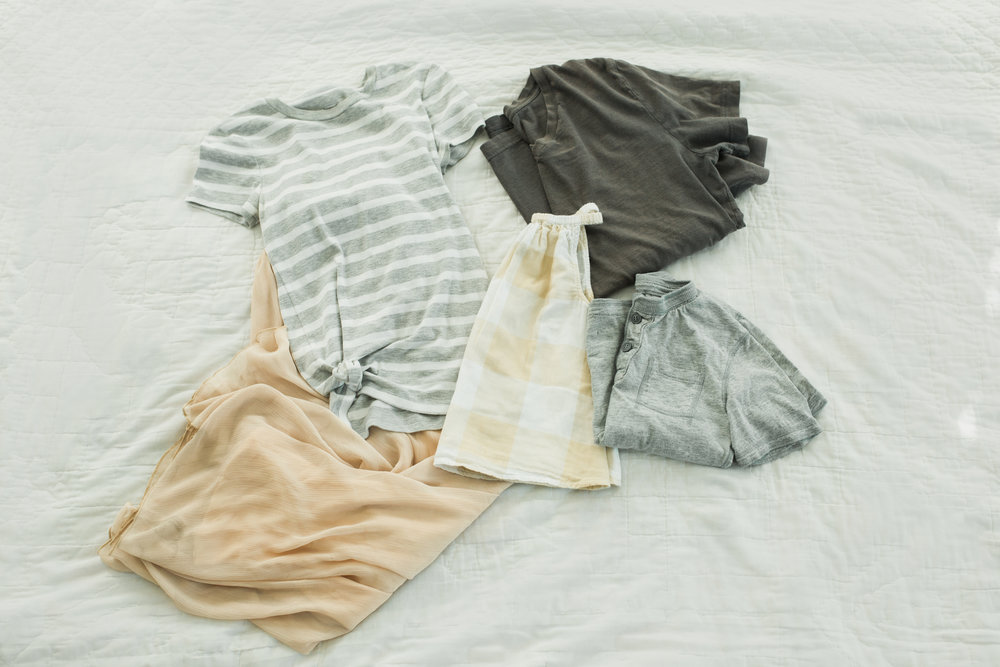 Knotted striped tee with a flowy blush skirt for mom. Gingham dress for girl. Grey henley for boy. Grey v-neck for dad. Since everything is so neutral and working well, I would put dad and boy in khakis.