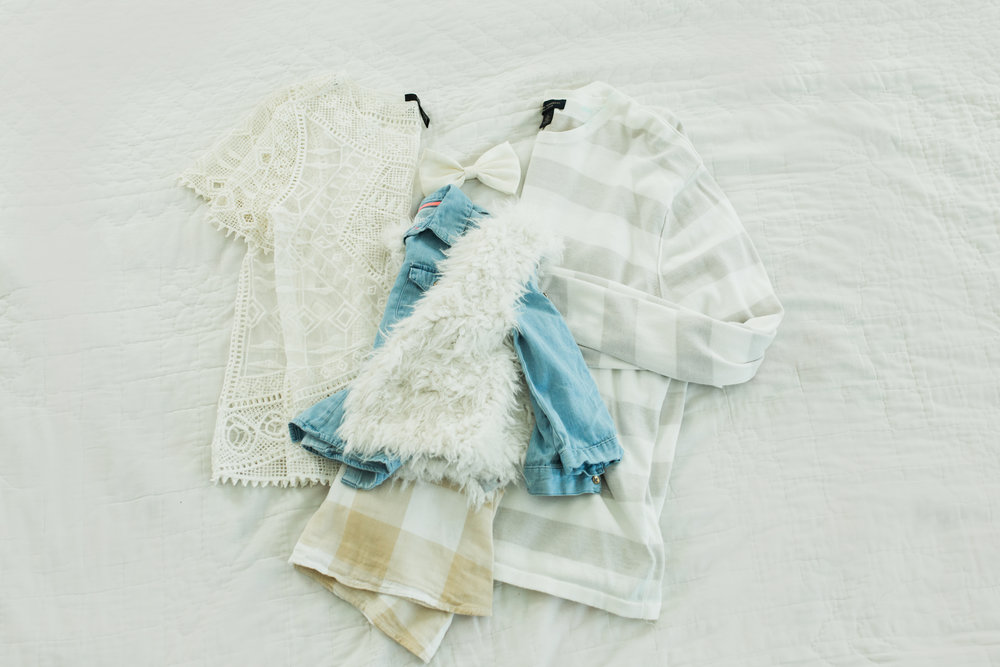 Family of 3 (if I did this look for my family I would need to buy something for my son. Perhaps an oatmeal tee?). Mom in a lacy top, paired with grey denim. Dad in striped sweater paired with grey khakis. Girl in chambray top and same dress as above with fur vest.