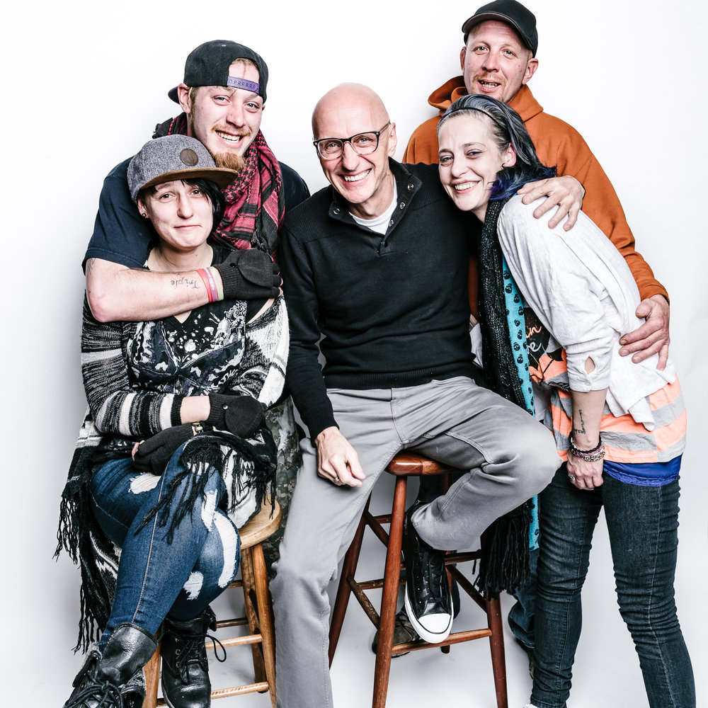 Founder + Head Photographer Randy Bacon with some of our beloved street friends and storytellers.