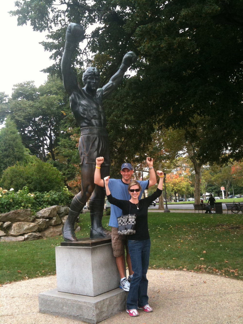 "Jody and her husband Travis with the ""Rocky"" statue in Philadelphia, 2 days before her surgery"