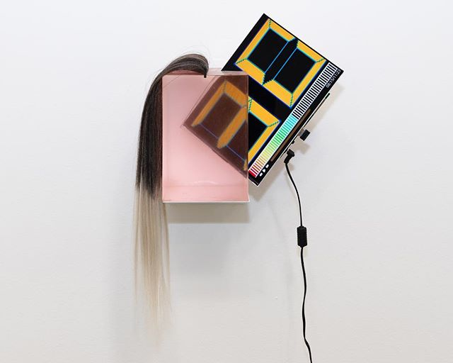 """Lena Imamura's """"Split head"""", 2014, resin, synthetic fiber, LCD screen, steel plate, remote control, 12 x 12 x 6 in.  This work is included in Destruction of Pleasure, a group exhibition curated by Lea Cetera with works by Alisa Baremboym, Sascha Braunig, Lea Cetera, Jesse Cohen, Ivy Haldeman, Lena Imamura, Avery Singer, and Pinar Yolaçan.  Destruction of Pleasure brings together eight artists that play with feminism, corporeality, illusion and surrealism in their work in order to create a perspective that complicates traditional expectations of the viewer. In her 1975 essay Visual Pleasure and Narrative Cinema, Laura Mulvey called for the destruction of the traditional male-oriented gaze and the cultivation of alternative perspectives. Mulvey declared """"Destruction of Pleasure is a Radical Weapon"""", that the traditional """"scopophilic"""" view of film had always belonged to the masculine, and that there would be a conception of a new viewpoint, that of an unknown, new """"language of desire"""". The works in the show offer ecstatic new narratives, histories, considerations from a new generation of female artists creating across a variety of media a visual language that is uniquely their own.  This is the inaugural show in the Colloquy series, where artists are invited to curate a show that includes their own work alongside other artists they are in dialog with. These exhibitions present an archive of a specific discourse while providing an additional layer of context to the artists practice.  The show will be up until November 29 with galley hours by appointment only. Contact us to arrange a viewing: metametameta.org@gmail.com"""