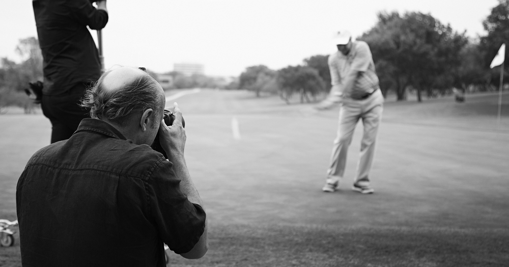 Andrew photographing President George W Bush for Golf Digest
