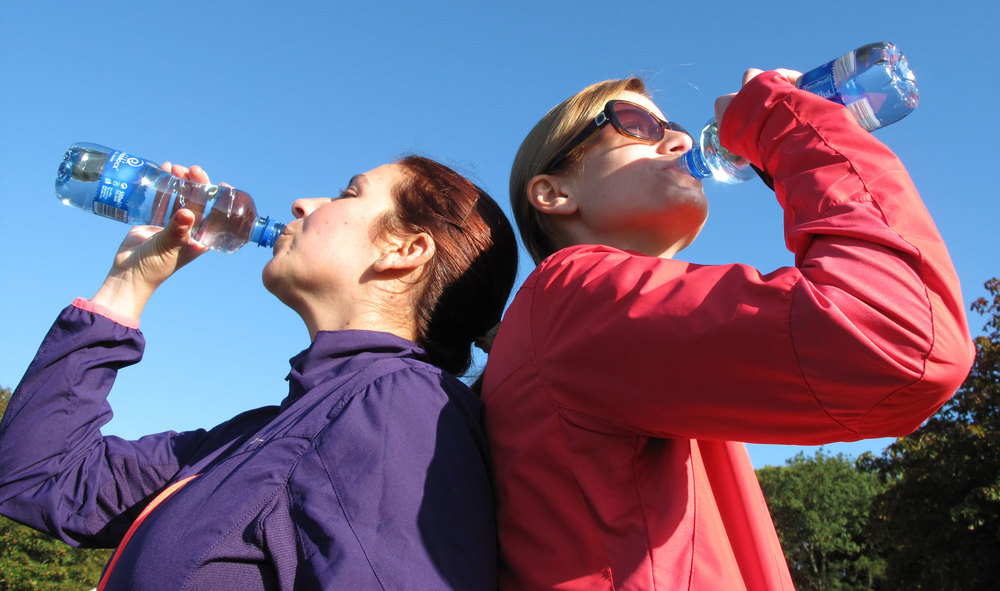 Two participants hydrate themsleves before the big run.