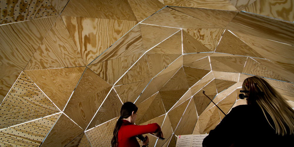 Acoustic Pavilion II   An architectural instrumental pavilion for classical music. Developed, designed and build for the Aalborg Culture Festival 2012 based on music, pine plywood, foam, acoustic simulations and evolutionary design process studies.