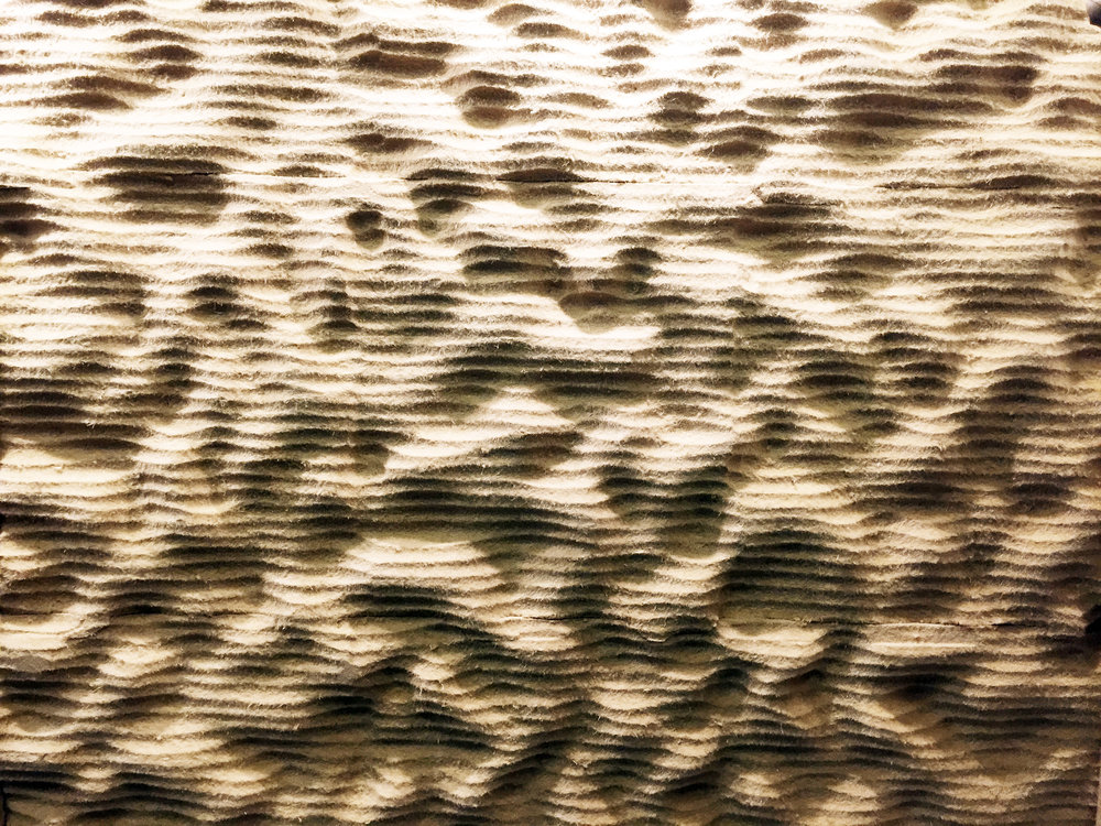 Acoustic Fibreboard Wall   An undulating expressive acoustic absorbing and scatting wall surface. Developed from low cost industrial fibreboard panels using an industrial milling head on robot arm setup. Made on commission for the Building Green Fair 2017 in Copenhagen, Denmark.