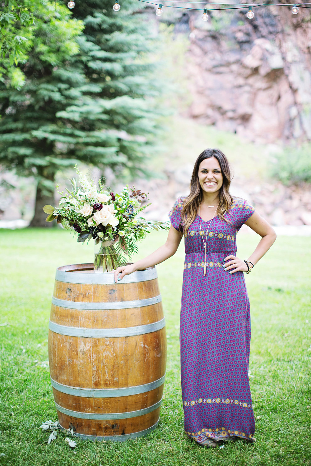 "darcy hummel- lead wedding + event planner   Darcy Hummel is a Colorado native who loves to travel and see new things. She has been to Iceland, traveled throughout Europe and even lived in Belize for awhile. Her ultimate passion is helping others. She loves working at Children's Homes and giving to people in need. If she's not running around Fort Collins with her two puppies, she's at home ""Pinteresting"" new design ideas for weddings and styled shoots. She loves DIY projects and practicing her calligraphy. Darcy loves to laugh and keep things light but is a seasoned pro!   Darcy has been in the wedding industry for 4 years and loves every minute of it. From the initial consultation, to the wedding day, she enjoys the process. The father-daughter dance always brings her to tears and she loves getting to know the couples on a personal level. She loves that weddings are always unique, each one has a totally different look, feel & energy than the last. She is excited to meet you and help you bring your wedding day to life."