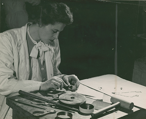 Gay Barrett, Applied Arts student, creates a piece of jewellery at the Owens, 1953, Collection of Aaron Roulston, Max Roulston's paper