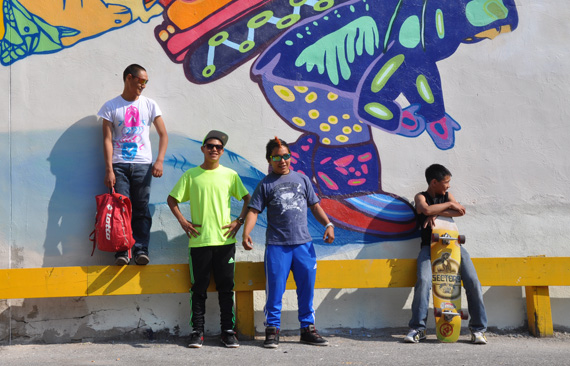 From left, Cie Taqiasaq, Parr Etidloie, Audi Qinnuayuaq and Latch Akesuk, stand in front of the completed mural they designed and painted onto the side of a building in downtown Toronto. (PHOTO BY SARAH ROGERS)