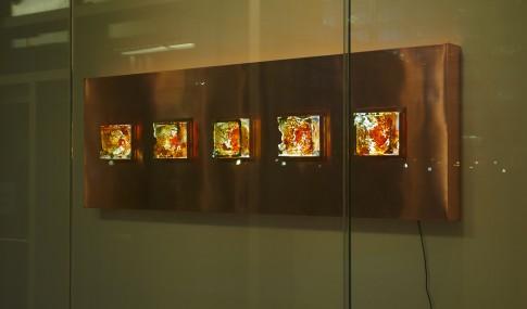 Aurora Darwin.  1:5  , 2015. Copper, wood, LED light panel, sandcast glass. Photo: Tom Bilenkey