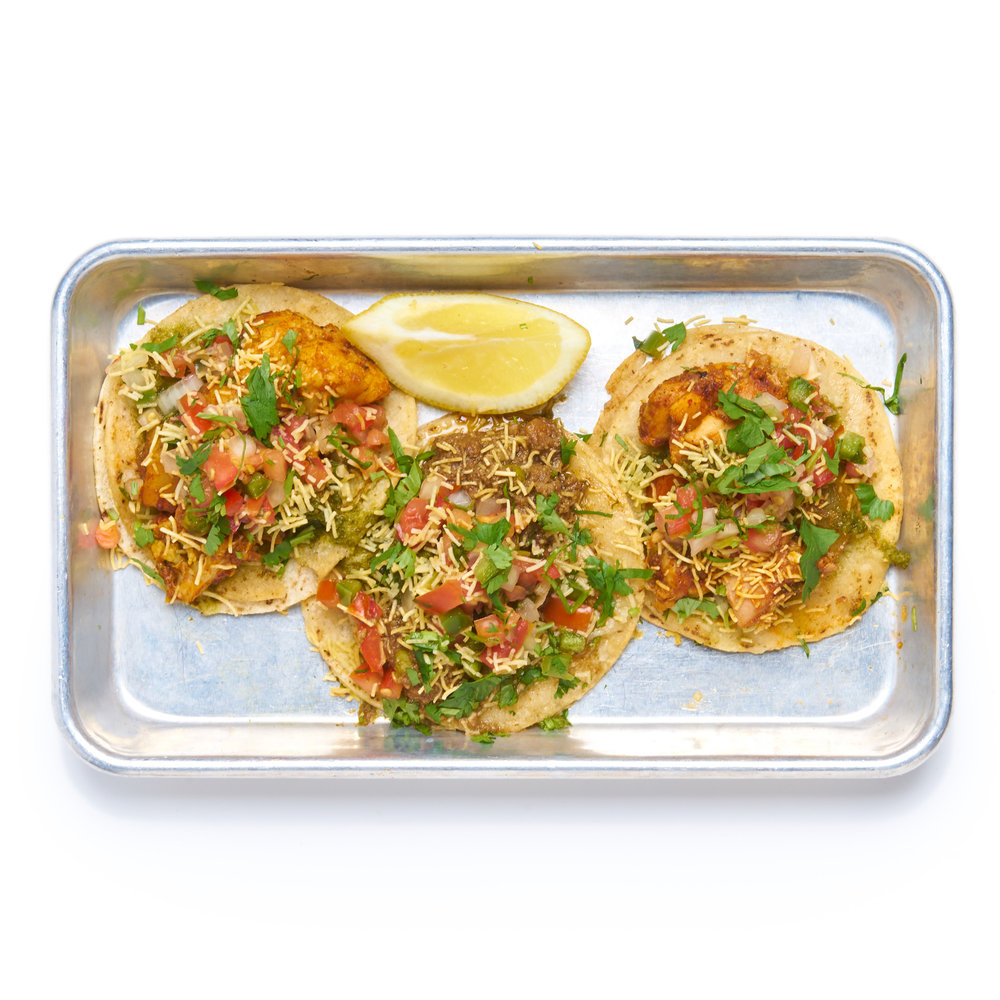 TACOS   three tacos, la palma corn tortillas, pico kachumber, cilantro chutney, crispy sev noodles (GF)  choice of chicken or aloo gobi (V)