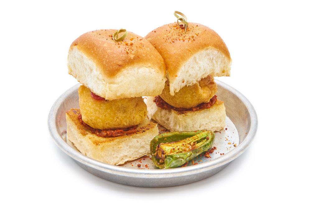 VADA PAV   mashed potato fritter sandwiched between an amul buttered bun, garlic chutney, bombay dust (VG) (go butterless for V)