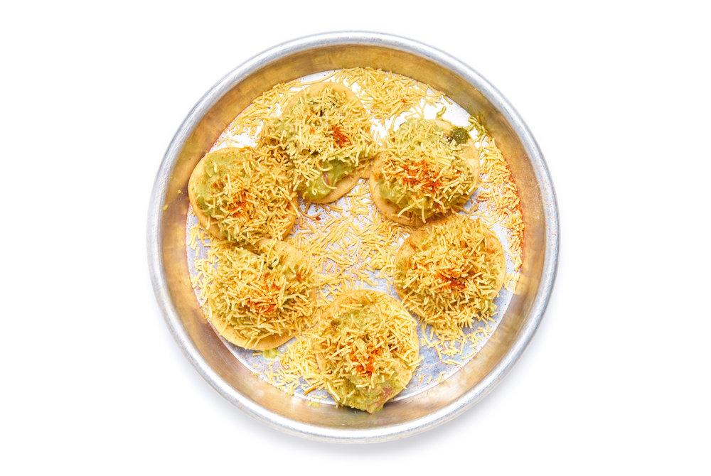 GUAC SEV PURI   crisp papdi chips, guacamole, chutneys, crispy sev noodles (V)