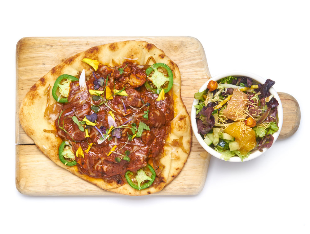 NAUGHTY NAAN a flatbread of wheat or flour kulcha naan, cheese, caramelized onions, shaved jalapeños, seasonal organic green side salad choice of chicken or paneer