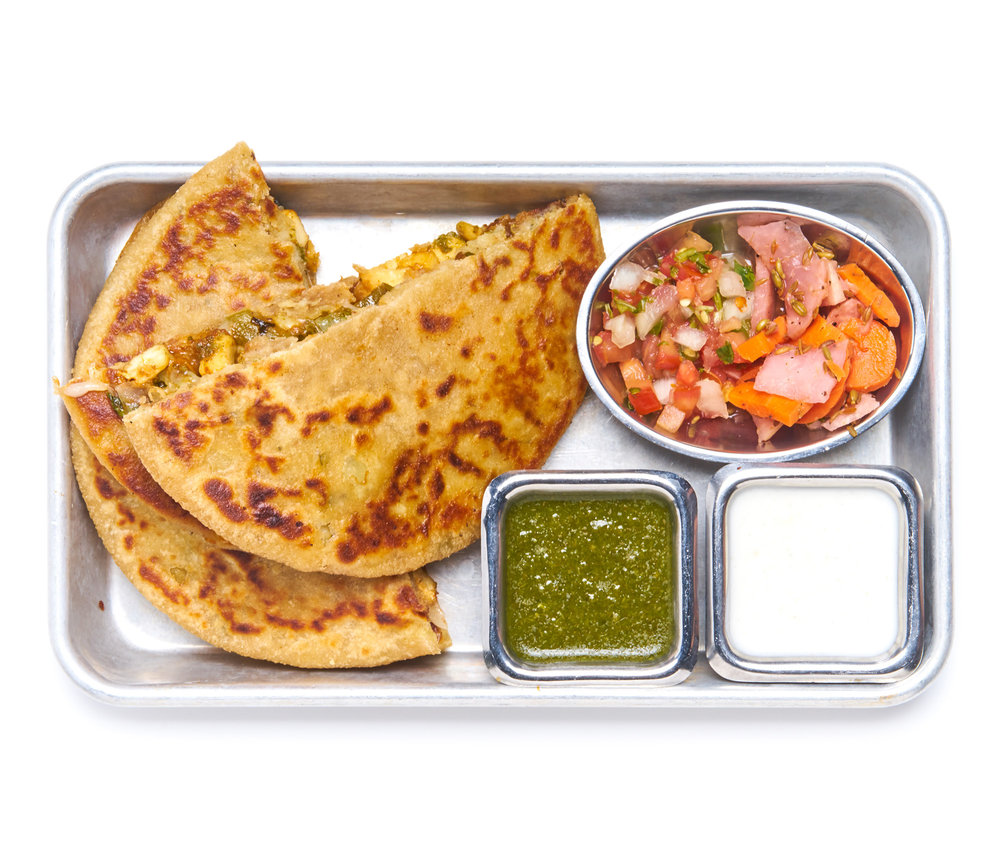 QUESADILLIX deep rooted in the streets of punjab; whole wheat potato stuffed parantha flatbread with your choice of filling, pickles, chaat masala yogurt, chutney choice of chicken, paneer, lamb or vegan chicken