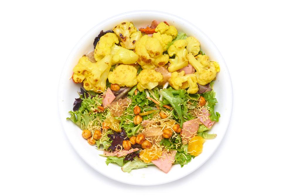BABLOO & CHOTU SALAD   local organic seasonal greens, cumin & fennel vinaigrette, lil naan crostini  cauliflower (V), guacamole (V) or chicken