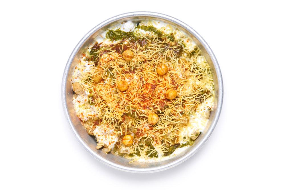 KACHORI CHAAT rajasthani hard shelled round puris stuffed with thar desert lentils, potato garbanzo mash, chaat masala yogurt (VG)