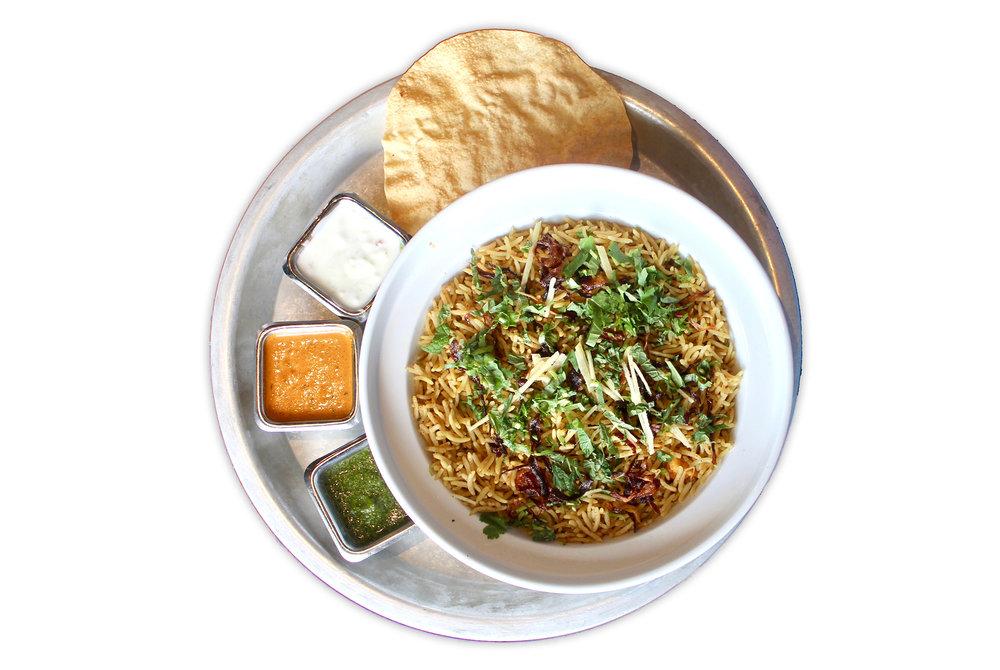 BIRYANI an indian paella of sorts - aged basmati sella rice, whole house roasted spices, salan sauce, yogurt raita, chutney choice of chicken, paneer (VG) or free range plant protein (VG)