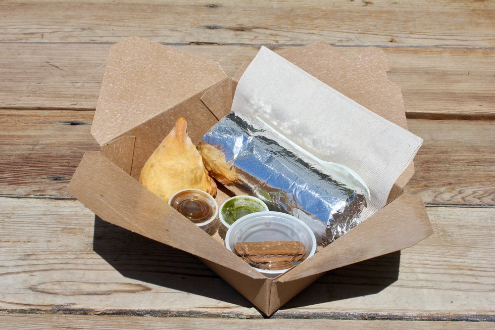 BURRITO BOX    $14.5/person  each box includes a burrito, samosa w/chutneys and indian cookies    choice of:  chicken tikka masala paneer tikka masala (VG) hella vegan (V) aloo gobi (V) lamb ($1) free range plant protein (V)