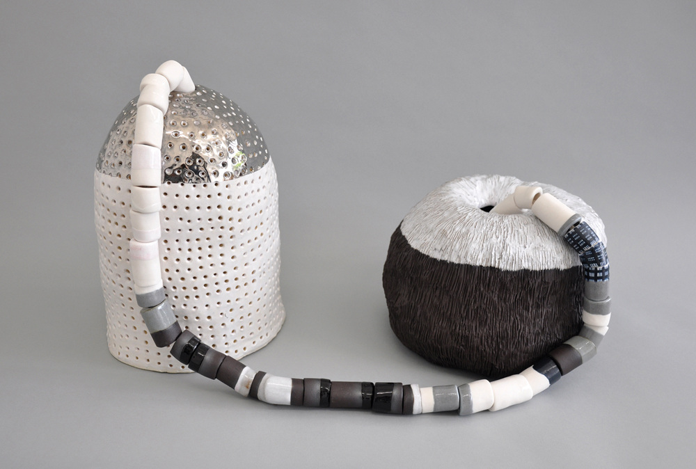 Transponders, 2015 Stoneware, porcelain, platinum luster, cotton rope. 11 x 25.5 x 9 inches
