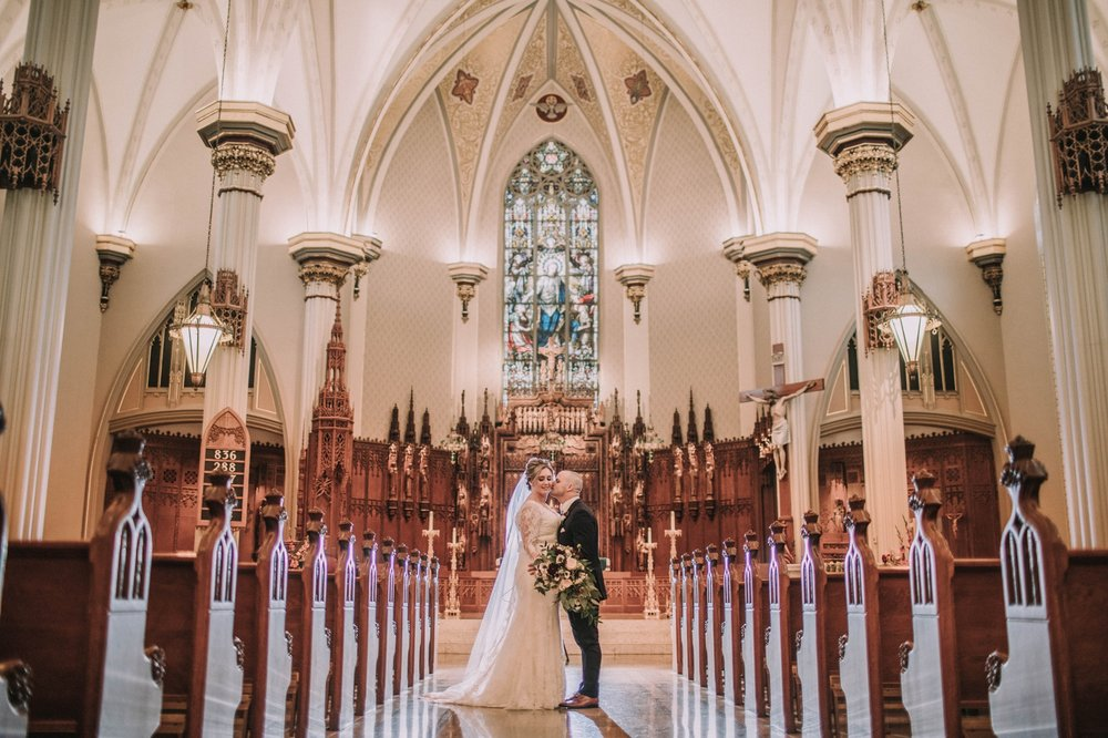 cathedral bride groom kiss