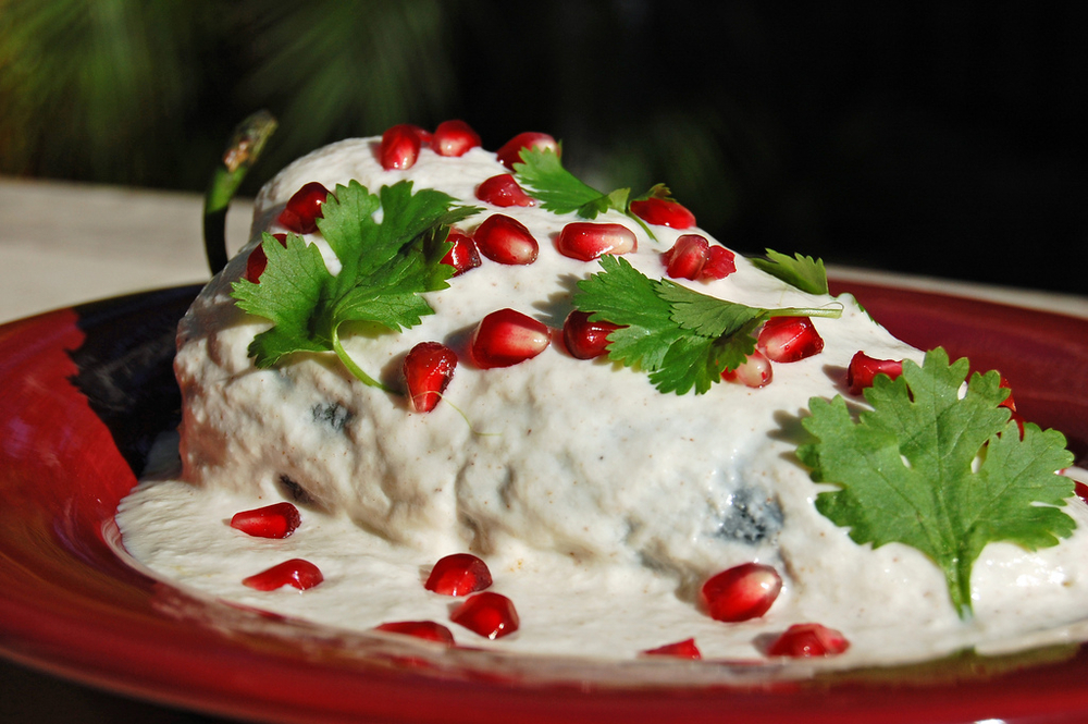 Photo   credit  :      https://www.flickr.com/photos/masaassassin/3955065208/in/photostream/    Chiles en Nogada (Stuffed peppers with walnut  cream sauce). Scroll down for a  delicious r ecipe!