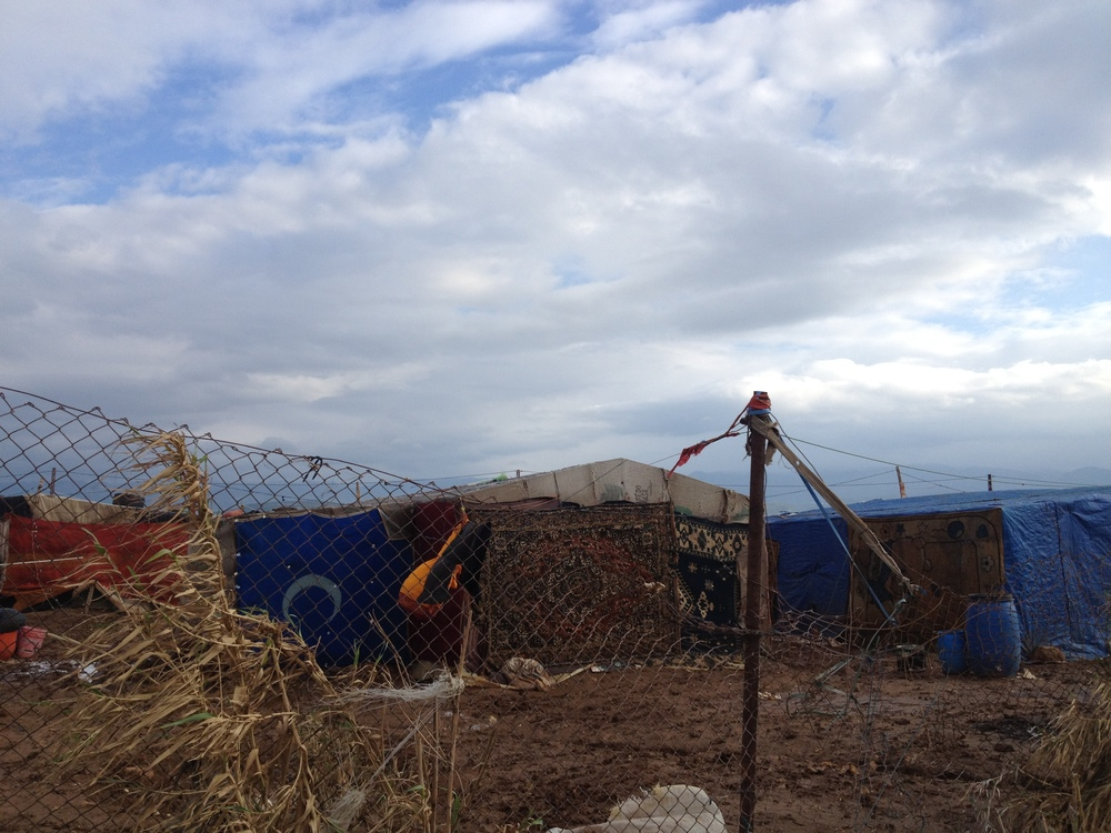 Informal refugee camp next to the Syrian border. 'Akkar (North Lebanon), 2013. Photo taken by Estella Carpi.