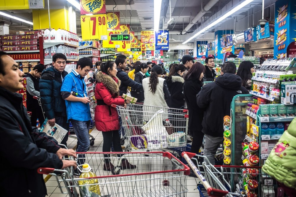 Uyghur and Han shoppers at the local Carrefour supermarket.