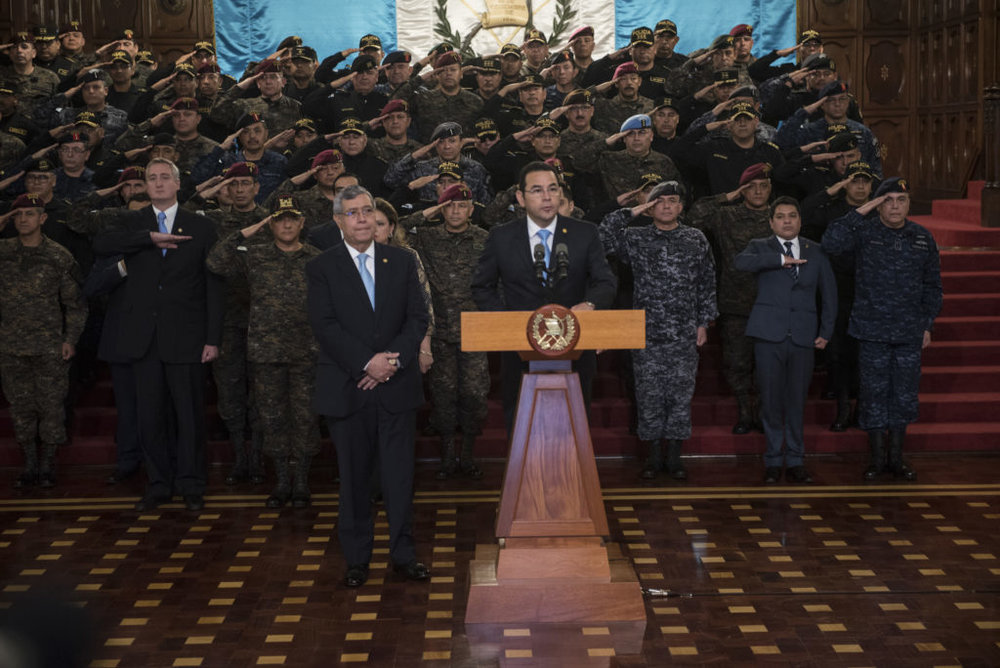 Morales with Military announcing the end of CICIG Mandate on Aug. 31.   Source