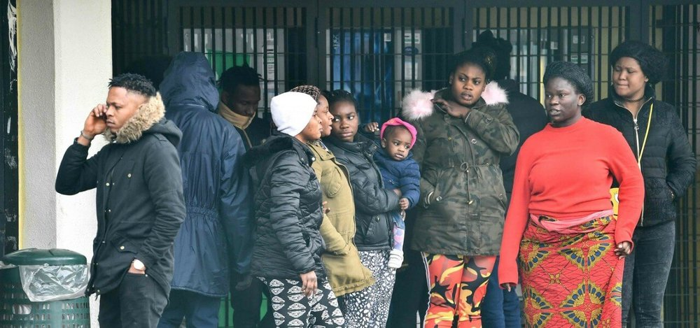 Women with Children being evacuated from Castel Nuovo di Porto .   Source