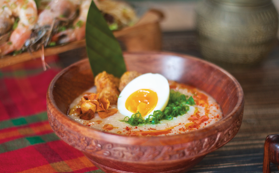 Arroz caldo, 6 minute egg, fried chicken, annatto oil. Photo credit: Farrah Skeiky