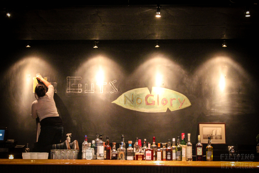 Tasha Camba of Escolta St. Snatchers Social Club sketches out the No Guts No Glory banner above the bar.
